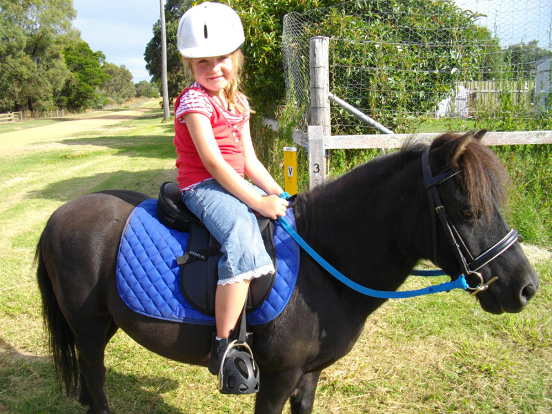 Aria riding Mags