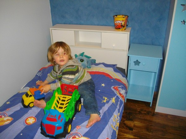 Levi playing on his bed in his new room