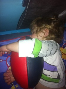 Levi sleeping with his football.