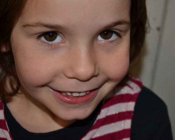 A portrait of my daughter Veruca being cheeky