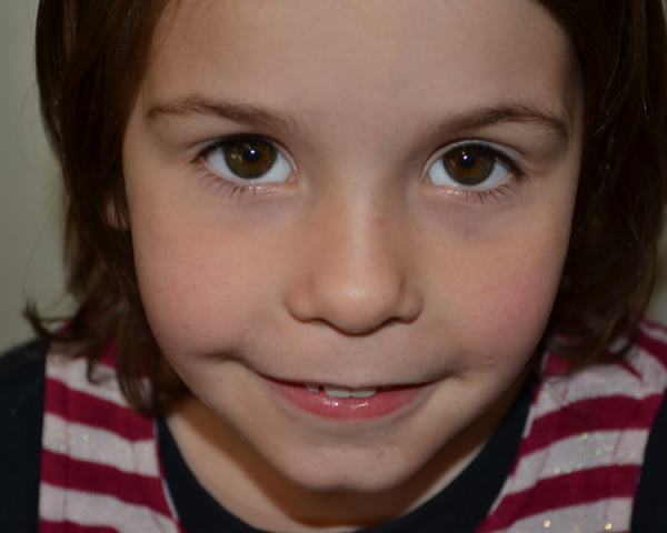 A portrait of my daughter Veruca smiling