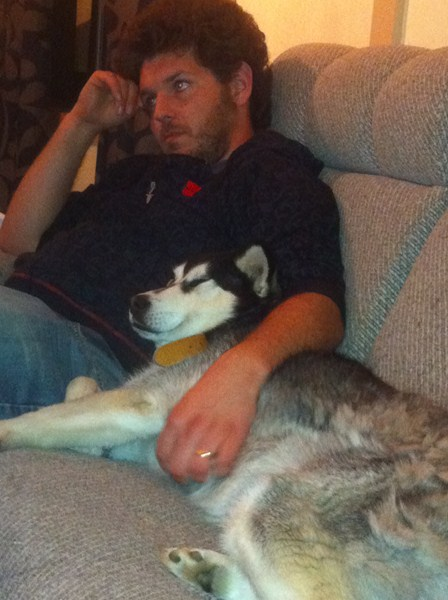 Brian and Mishka our husky on the couch!