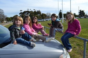 Kids sitting on the car.