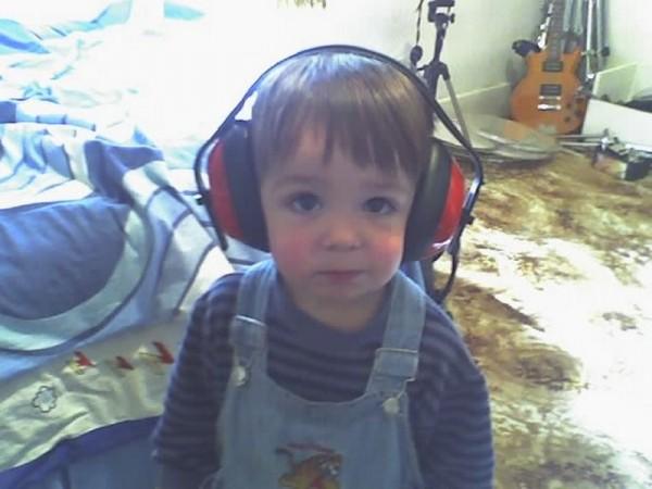 Jai wearing earphones