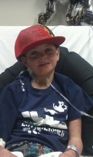 Jordan in hospital with cap on