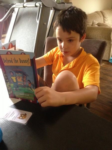 Jai reading at the homework Station